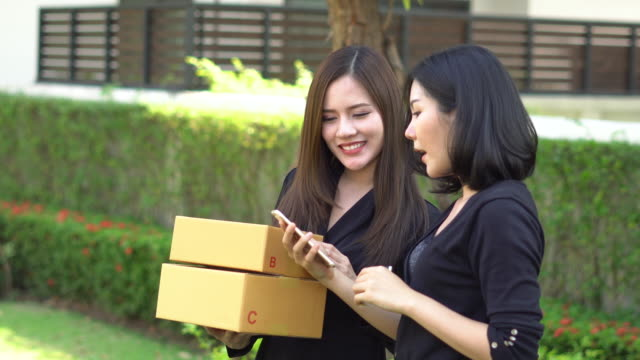 woman talking with partnership prepare packaging for sent to customer