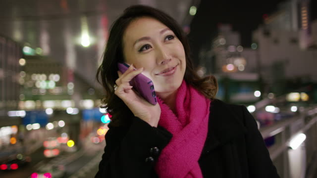 cu a woman talks on her phone / tokyo, japan - long distance relationship stock videos & royalty-free footage