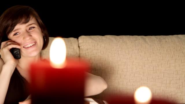woman talks on phone by candlelight - sladdlös telefon bildbanksvideor och videomaterial från bakom kulisserna