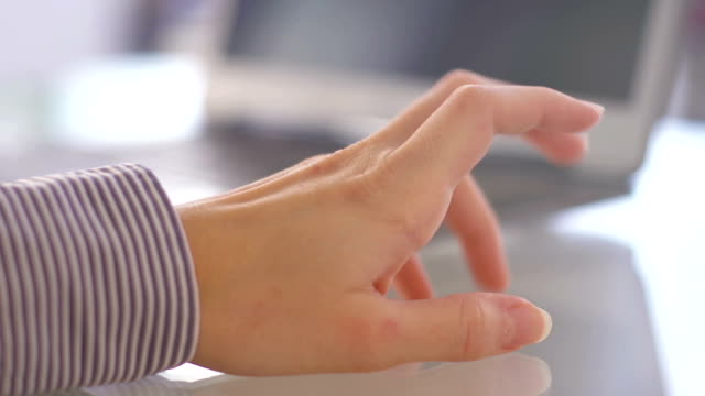 Woman tapping nervously with her hand