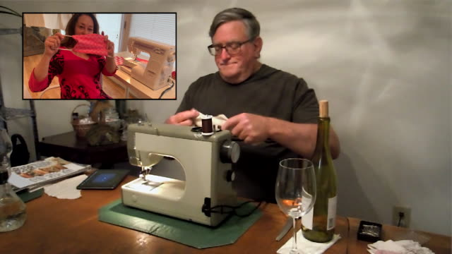 woman teaches a man how to sew together a face mask via video call. - sewing stock videos & royalty-free footage