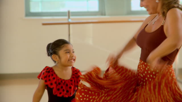 CU, TU, Woman teaching girl (4-5) flamenco dancing, Richmond, Virginia, USA