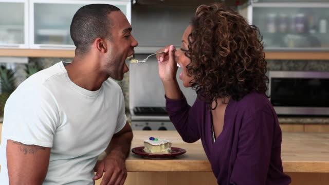 woman teasing boyfriend and feeding him cake - teasing stock videos & royalty-free footage