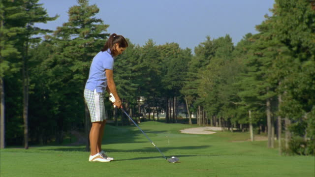 ms, woman teeing off on golf course, saco, maine, usa - golf swing stock videos & royalty-free footage