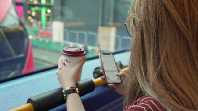woman texting on a bus - commuter stock videos & royalty-free footage