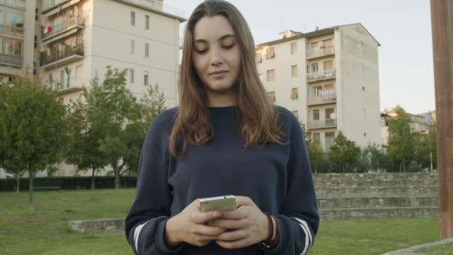 woman texting - blick nach unten stock-videos und b-roll-filmmaterial