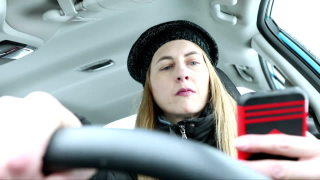 woman texting while driving - danger stock videos & royalty-free footage