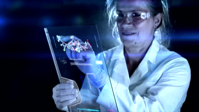 woman the scientist is analysing structure dna.. - replication bubble stock videos and b-roll footage