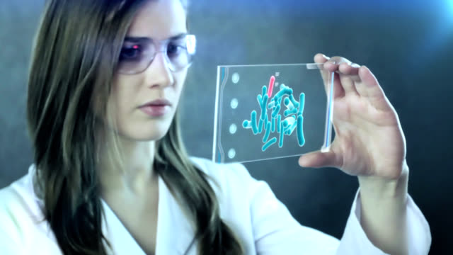 woman the scientist is analysing structure dna. - replication bubble stock videos and b-roll footage