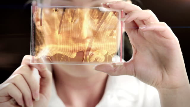 stockvideo's en b-roll-footage met woman the scientist is analysing structure of hair. - cosmetica
