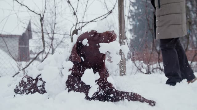 slo mo woman throwing a shovel of snow on a dog - snow vehicle stock videos and b-roll footage