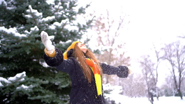 woman throws snow in the air - human limb stock videos & royalty-free footage