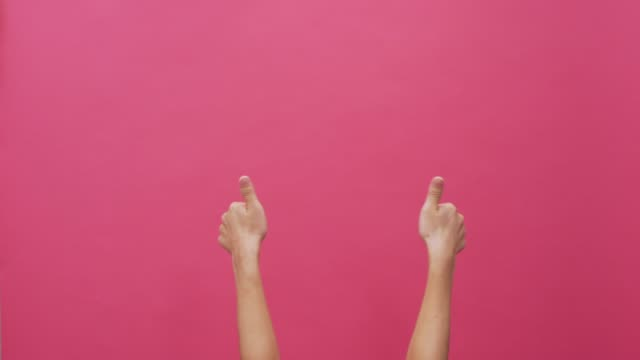 woman thumb up on isolated pink background 4k - agreement stock videos & royalty-free footage