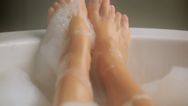 ms tu woman toes in bubble-bath / seattle, wa, united states - entspannung stock-videos und b-roll-filmmaterial