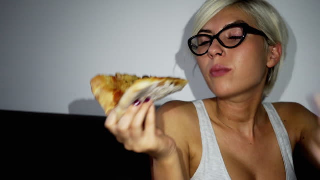 woman took break from diet and eating pizza - short hair stock videos & royalty-free footage