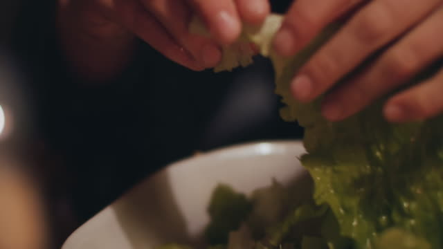 woman tossing and tearing salad leaves - salad stock videos & royalty-free footage