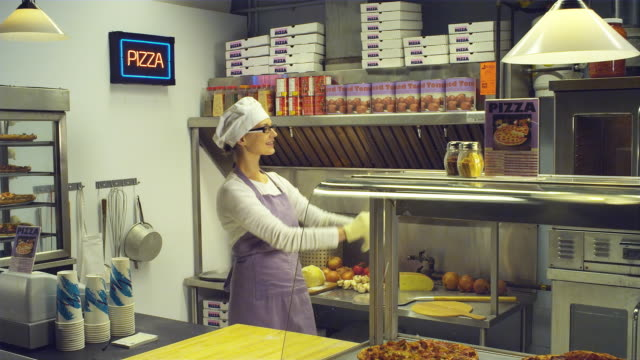 ms woman tossing pizza in pizza kitchen / vancouver, british columbia, canada - throwing stock videos & royalty-free footage