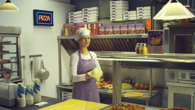 ms woman tossing pizza in pizza kitchen / vancouver, british columbia, canada - chef's hat stock videos & royalty-free footage