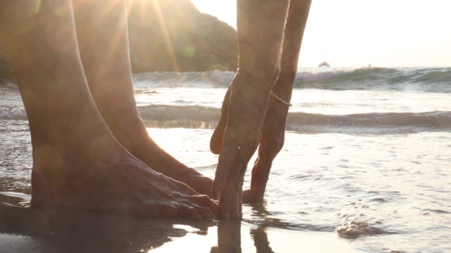 woman touches toes, on empty beach - toe stock videos & royalty-free footage