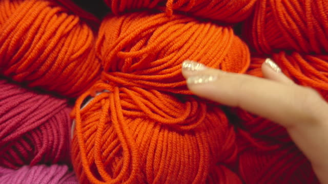 woman touching ball of wool close up shot