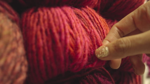 woman touching ball of wool close up shot - ball of wool stock videos & royalty-free footage