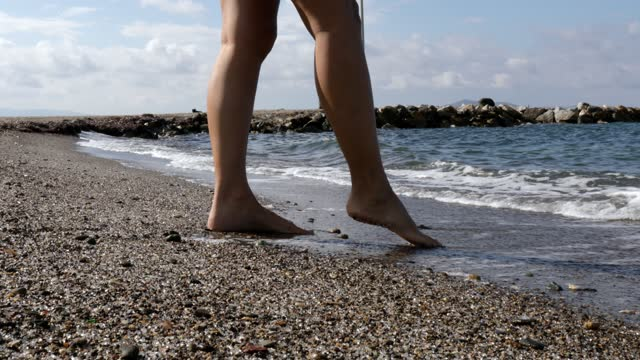woman touching sea with her toe - toe stock videos & royalty-free footage