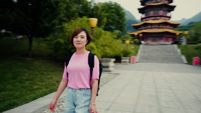 woman tourist in temple,xi'an,china. - east asian culture stock videos & royalty-free footage