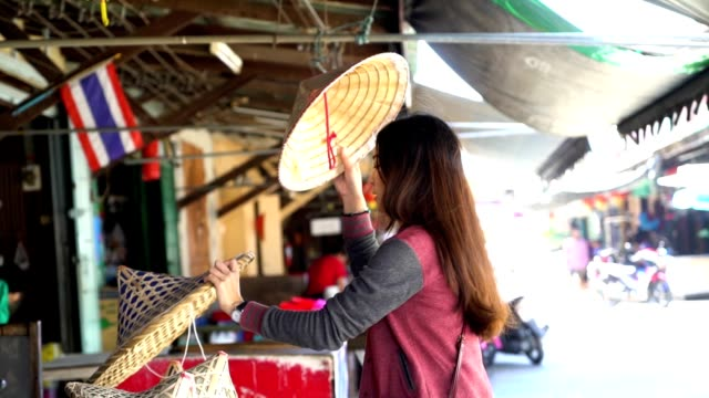 woman tourist is wearing (vietnamese hat) - hat stock videos & royalty-free footage
