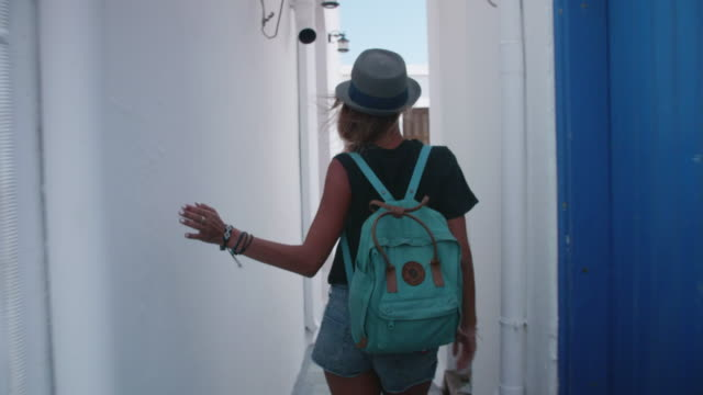 a woman tourist sightseeing in narrow streets of skyros, greece. - hat stock videos & royalty-free footage