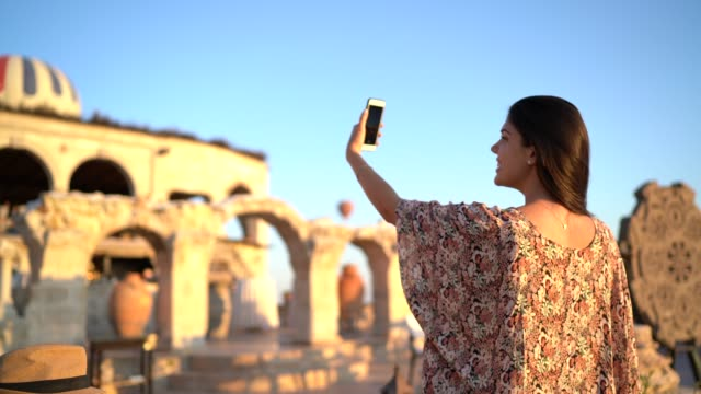 woman tourist taking a selfie at cappadocia, turkey - one young woman only stock videos & royalty-free footage