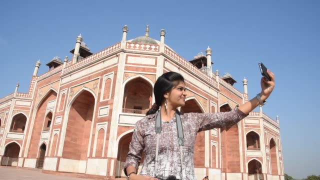 woman tourist taking photos at humayun's tomb, delhi, india, - tourism stock videos & royalty-free footage