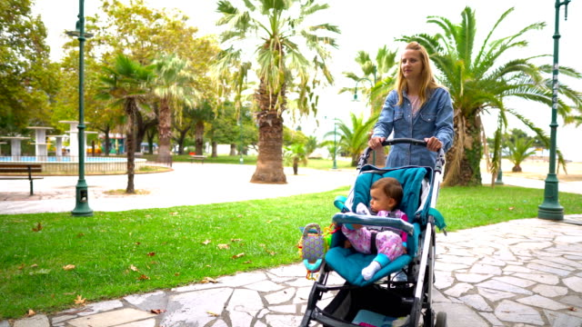 woman tourist walking with baby stroller - three wheeled pushchair stock videos & royalty-free footage