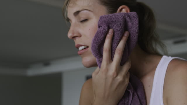 woman toweling off after working out - towel stock videos and b-roll footage
