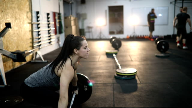 woman training in gym - persistence stock videos & royalty-free footage