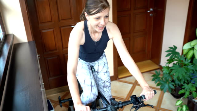 woman training on cycle home trainer - exercise bike stock videos & royalty-free footage