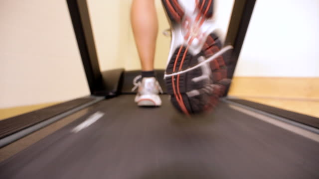 woman training on treadmill in home - treadmill stock videos & royalty-free footage