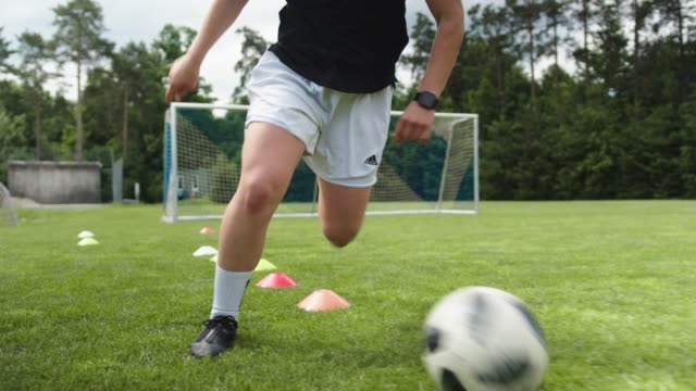 woman training soccer in slow motion - scoring stock videos & royalty-free footage