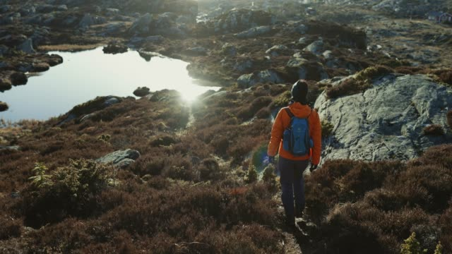 woman travel adventures: mountain hiking in norway - scenics stock videos & royalty-free footage