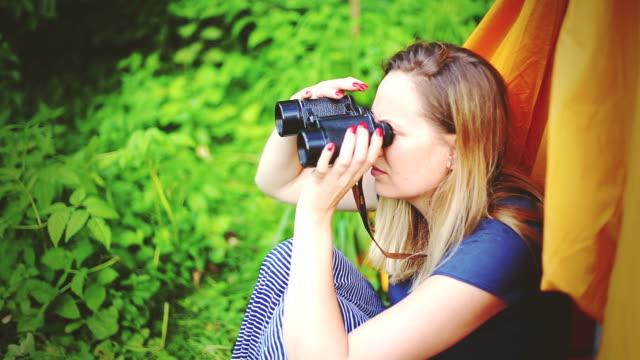 woman traveler looking through binoculars