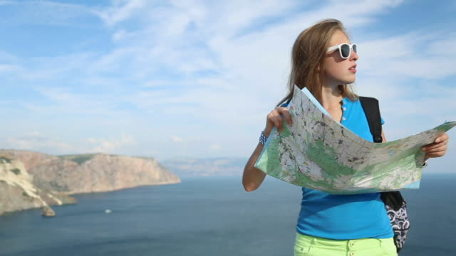 woman traveler with a map of the coast - fine art portrait stock videos & royalty-free footage