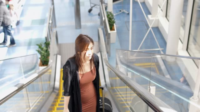 woman traveler with luggage  at terminal airport - airport terminal stock videos & royalty-free footage