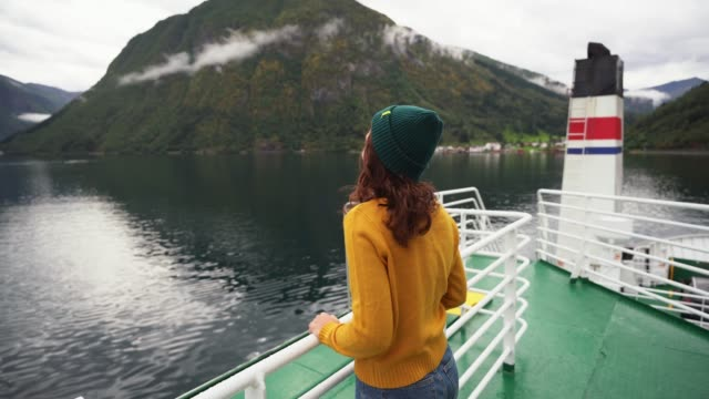 woman traveling by ferry in norway - passenger ship stock videos & royalty-free footage