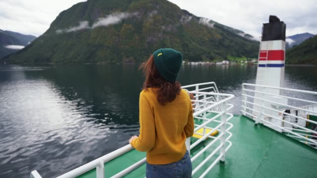 woman traveling by ferry in norway - ferry stock videos & royalty-free footage