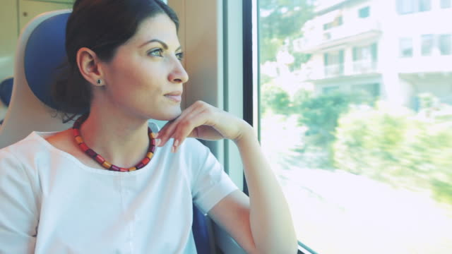 woman traveling by train. - tourist train stock videos and b-roll footage