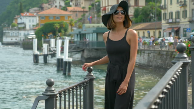 A woman traveling in a luxury resort town near Lake Como, Italy, Europe. - Slow Motion
