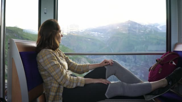 woman traveling in gornergrat train - compartment stock videos & royalty-free footage