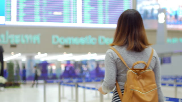 woman traveller passenger in terminal airport - passenger stock videos & royalty-free footage
