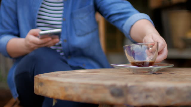 woman traveller take a coffee at outdoors cafe in nature - pavement cafe stock videos and b-roll footage