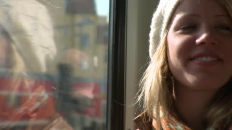 cu woman travelling in train / berlin, germany - blondes haar stock-videos und b-roll-filmmaterial