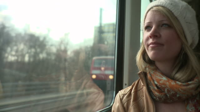 MS Woman travelling in train / Berlin, Germany
